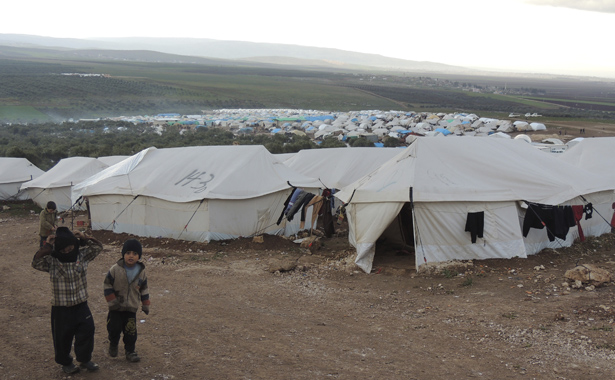Syrian refugees are seen in a refugee camp on the Syrian side of the border with Turkey, near Idlib in this picture provided by Shaam News Network - image